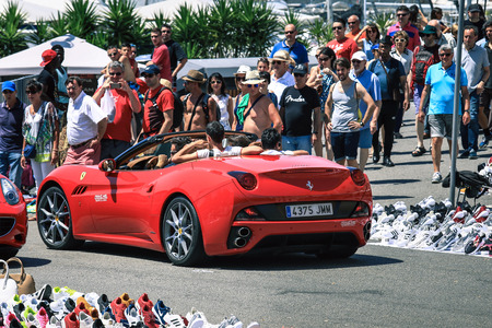 supercar: BARCELONA, SPAIN - JUNE 25, 2016 : Tourists rent supercar Ferrari in Barcelona? Expensive cars and other material symbols are visible everywhere. Editorial
