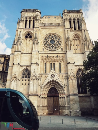 style: Bordeaux-France October 26, 2016 : tram is passing by Bordeaux cathedral of Saint Andrew in vintage style