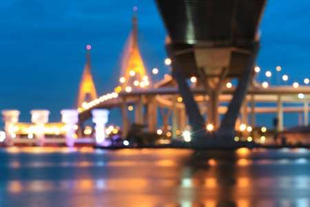 booked: Blurred of King rama 9 bridge at twilight, over the Chao Phraya river. connects the Yan Nawa district to Rat Burana district as a part of the Dao Khanong.