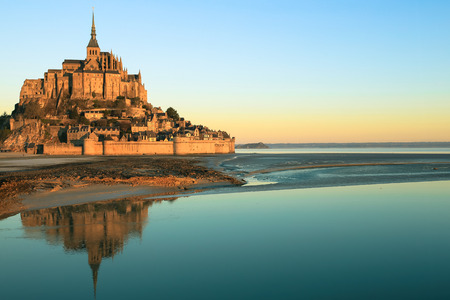 mount saint michael: Morning light on Mont Saint Michel and its reflection in Normandy - France