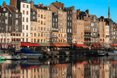 Honfleur, France - December 30, 2016 : Morning light on building at Honfleur port is a truly picturesque and one of charming harbour in France