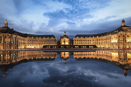 Reflection of Place De La Bourse and tramway in Bordeaux, France. A Unesco World Heritage Stock Photo - 69752256