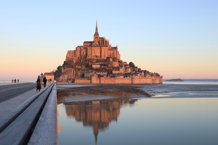Morning light on Mont Saint Michel and its reflection in Normandy - France