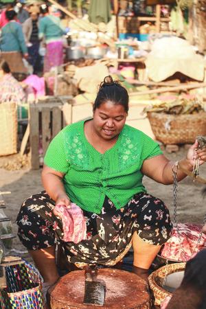 BAGAN, MYANMAR - Fabruary 3, 2017 : Myanmar local butcher preparing the meat for the fresh market