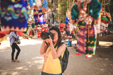BAGAN, MYANMAR - Fabruary 3, 2017 : Selective focus on photographer taking picture of Myanmar string puppets in Bagan