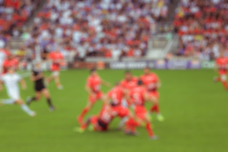 scrum: Blurred background of rugby players fighting, Outdoor sport Stock Photo