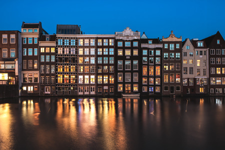 Traditional old buildings in Amsterdam at twilight, the Netherlands
