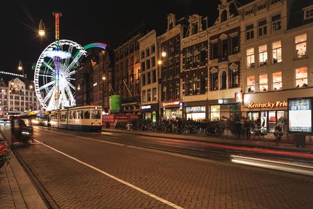 holland: Amsterdam-Netherlands, April 16, 2017 : Amsterdam street at night with long exposure ferris wheel