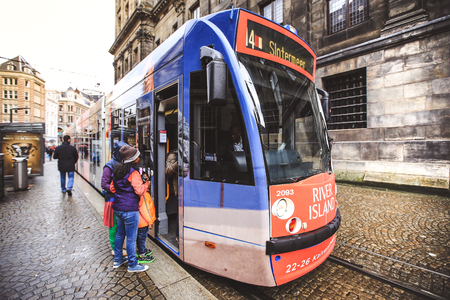 Amsterdam-Netherlands, April 18, 2017 : Modern tram in Amsterdam, tram is one of the quickest ways to get into and around the city centre Editorial