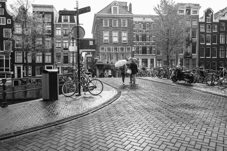 People Walking Under The Rain On Street In Amsterdam Holland Black And White Photography