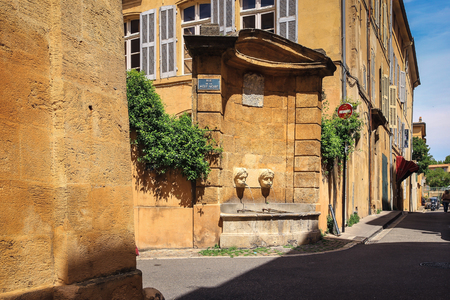 en: Ancient founatin from the old part of Aix en Provence town, France, typical provence architecture