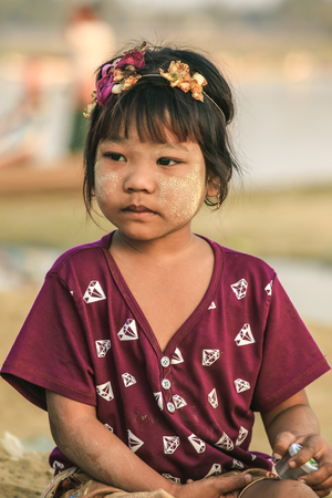 BAGAN, MYANMAR - Fabruary 3, 2017 : Portrait of a young burmese girl near U Peng bridge with thanaka on her face Editorial