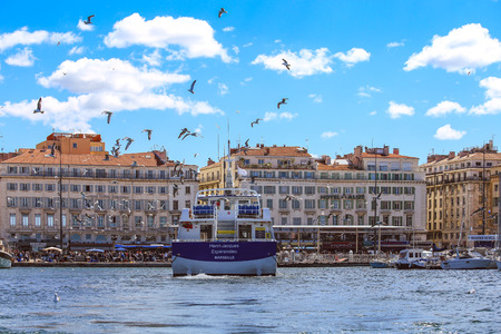 Marseille, France - May 17, 2017 : Sunday ambiance at the Old Port in Marseille, France. It is a busy port, used as a port and as a terminal for boat trips, and hosts a fish market