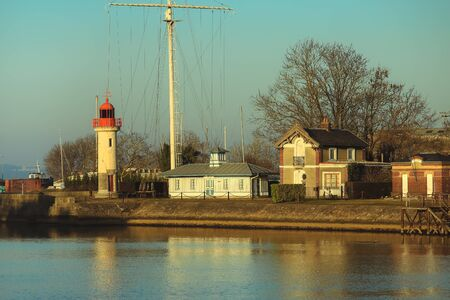 basse normandy: Beautiful morning light on Port and lighthouse of Honfleur, commune in the Calvados department in northwestern France
