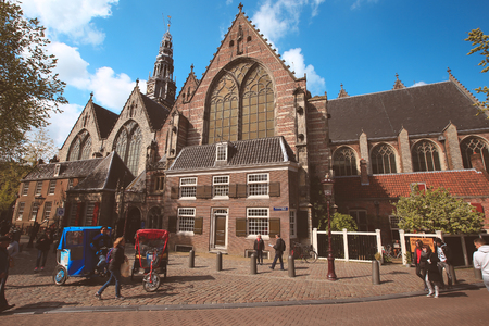 april 15: Amsterdam-Netherlands, April 15, 2017 : Oude Kerk (Old Church) and Voorburgwal canal in Amsterdam Editorial