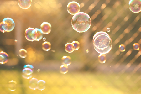 Blurred of floating soap bubbles of different colors and sizes in vintage style