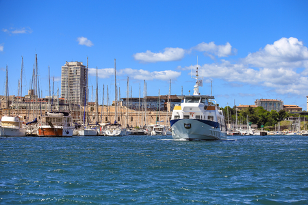 Selective focus on ferry boat at old port in Marseille, France with blue sky