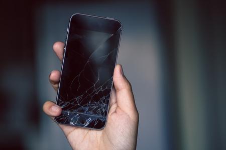 Broken phone screen in hand 스톡 콘텐츠