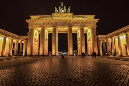 Classic vertical view of historic Brandenburg Gate Germany's most famous landmark and a national symbol at night