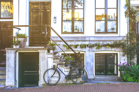 Bicycle park  in front of stairs to entrance doors of tradition building in Amsterdam, Netherlands
