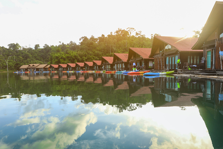 Traditional thai bamboo house resort, floating among mountains view and clear water in Ratchaprapa Dam at Khao Sok National Park, Suratthani Province, Thailand.