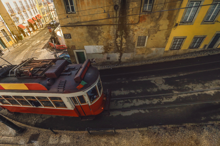 An old traditional tram carriage in the city centre of Lisbon, Portugal. The city kept old traditional tram in service within the historical part of the capital