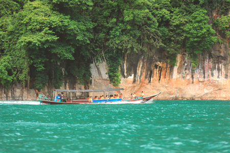 Krabi, Thailand - February 3, 2018 : Tourist group travel by long tail boat on Andaman sea in Thailand, Panning Photography Editorial