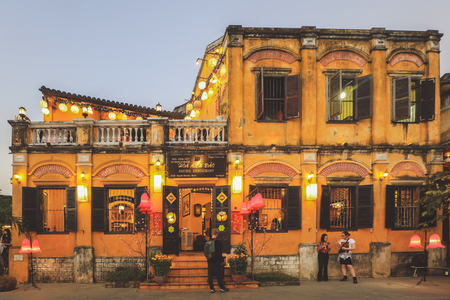 Hoi An, Vietnam - February 9, 2018 : Restaurants and shops on the banks of the Thu Bon river in Hoi An at night.