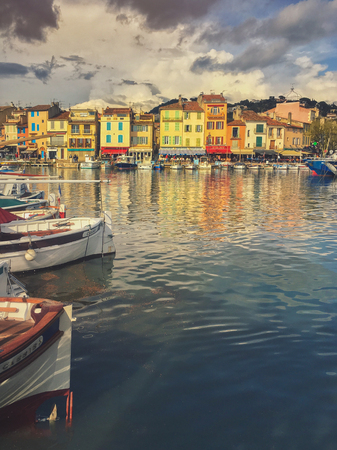 Cassis-France, April 7, 2019 : Colorful traditional houses on the promenade in the port of Cassis town Provence France Editorial