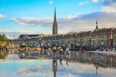 Bordeaux, France - 17 October, 2018 : Bordeaux water mirror full of people in one of the hotest summer day, having fun in the water, the pool is the largest water mirror in the world with 3450 sq.m. Editorial