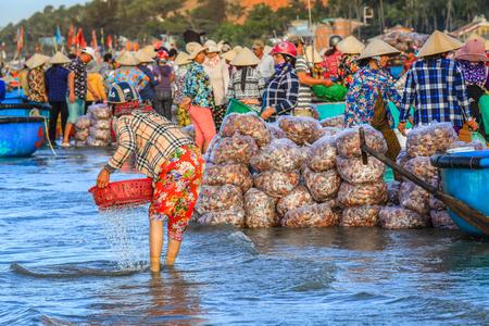 Mui ne Vietnam January 22, 2019 : Early morning fishing village in Mui ne, full of Vietnamese vendor on the beach