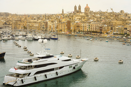 The Valletta port is a popular tourist attraction full of cafes and restaurants. Stock Photo