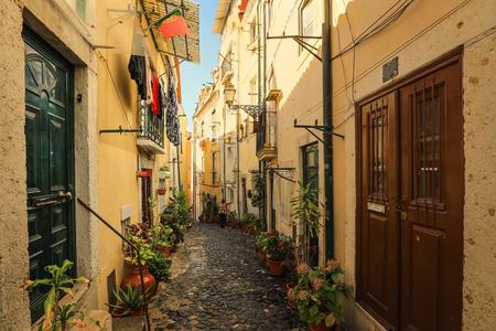 A narrow street in Alfama district in Lisbon, Portugal