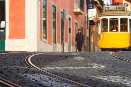 Selective focus on floor with blurred image of Street in the old district of the city, Lisbon, Portugal