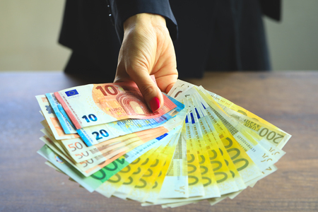 Euro money in business woman hand. Business Concept Imagens