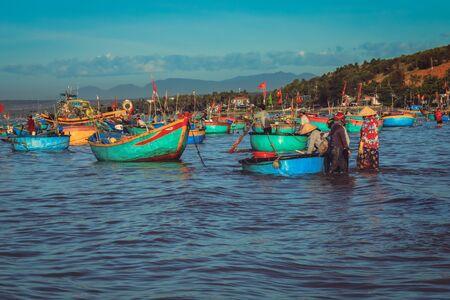Mui ne Vietnam January 22, 2019 : Early morning fishing village in Mui ne, full of Vietnamese fishermen on the beach