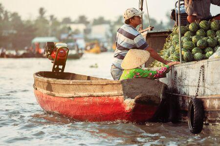 Mekong Delta - Vietnam - January 24, 2019 : Vietnamese vendors buying watermelon on Nga Nam floating market in Mekong Delta Vietnam.