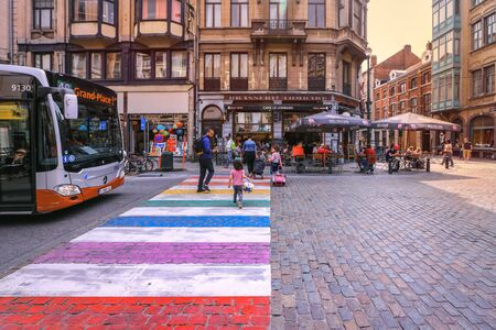 Brussels - Belgium, June 8, 2018 : people cross colorful pedestrian zebra in the old city center of Brussels