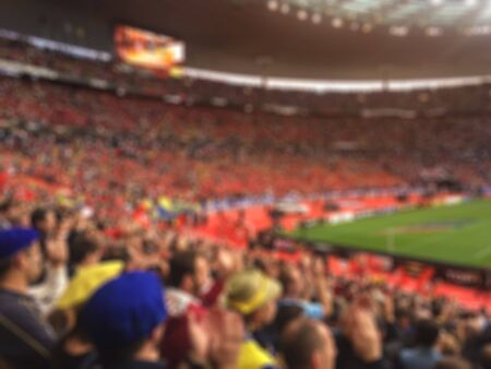 Blurred crowd of spectators on stadium at a sporting event Stock Photo
