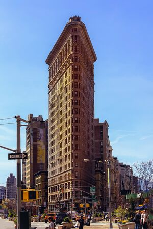 New York, USA - April 15, 2016 : Historic Flatiron Building in NYC. This iconic triangular building located in Manhattans Fifth Ave was completed in 1902