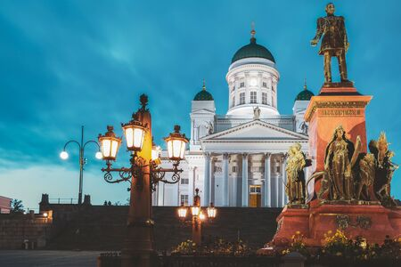 Twilight at Helsinki Cathedral, Helsinki, Finland. The Facade Fronted By A Statue Of Emperor Alexander II Of Russia