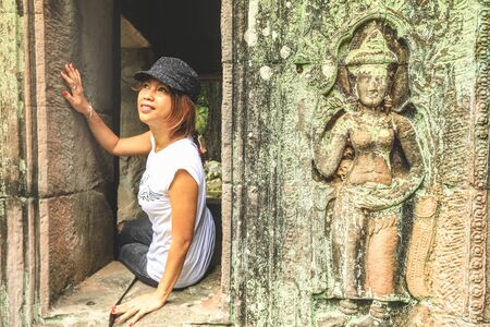 Traveler asian woman visiting ancient Ta Som temple in Angkor Archeological area in Cambodia