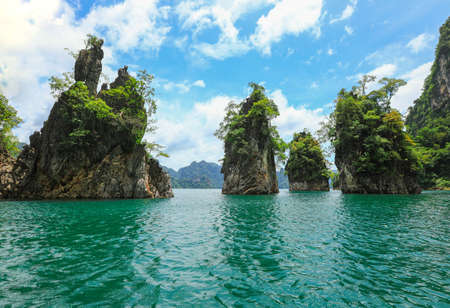Beautiful view limestone mountains and lake from boat in Ratchaprapa dam, Khoa Sok National Park, Surat Thani, Thailand