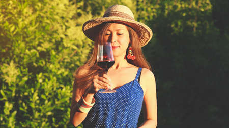 Happy asian woman drinking red wine, celebration concept