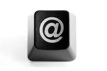 alphabet computer keyboard: @ Email sign on black keyboard key, isolated on white background