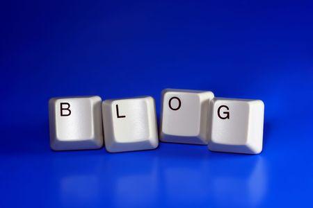 blog written with keyboard keys on blue background photo