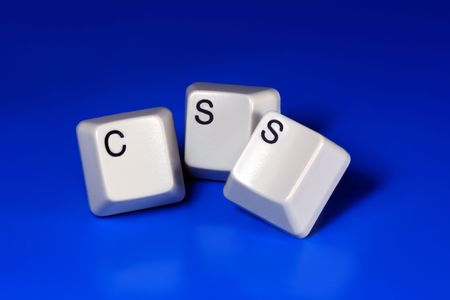 css: CSS written with keyboard keys on blue background Stock Photo