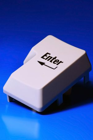 enter keyboard key on blue background photo