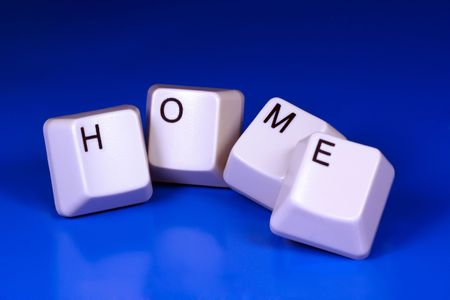 Home written with keyboard keys on blue background Stock Photo - 2546155