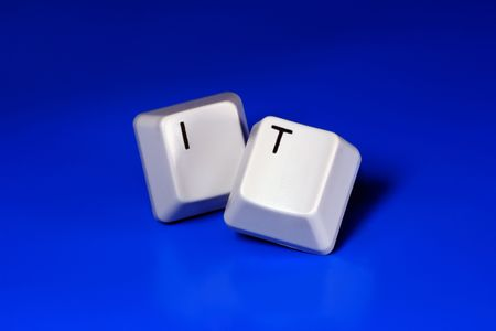IT Internet & Telecommunication written with keyboard keys on blue background Stock Photo - 2546301